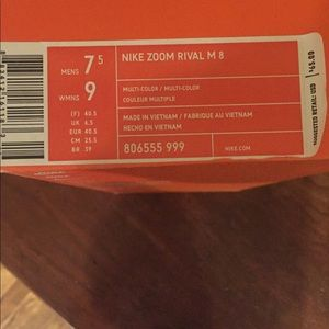 New in box Nike running spikes Women's size 9